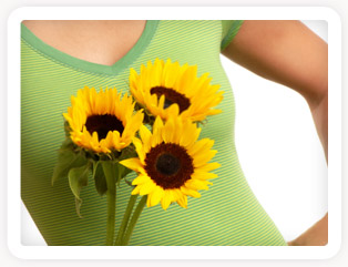 Woman with Flowers. Natural Breast Enhancement